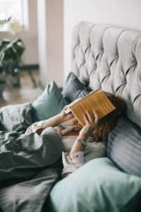 in-bed-with-book-image