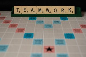 teamwork spelled out in scrabble tiles
